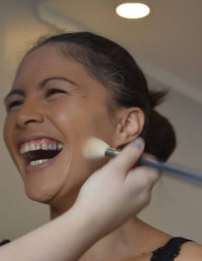make up brush on laughing woman